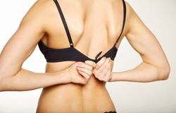 Woman Unhooking Her Bra Stock Photography