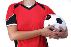 Woman in uniform holding a soccer ball Royalty Free Stock Images