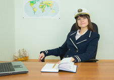 Woman in uniform of the seaman at tourist office Stock Images
