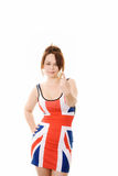 Woman in union jack dress giving a number 1 sign. Isolated on white Stock Image