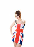 Woman in union jack dress holding thumb up. Isolated on white stock photography