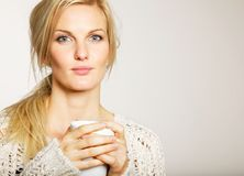 Woman with Unkept Hair Holding a Cup of Coffee Royalty Free Stock Photography