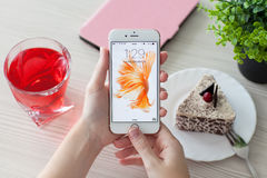 Woman unlock phone iPhone 6S Rose Gold over the table Royalty Free Stock Photography