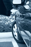 Woman unlocking car door royalty free stock image