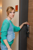 Woman Unlocking Door Stock Photography