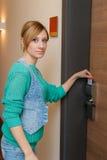 Woman Unlocking Door Stock Photography