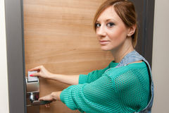 Woman Unlocking Door Stock Images