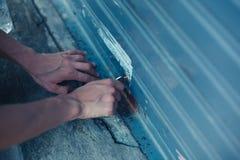 Woman unlocking garage door Royalty Free Stock Image