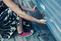 Woman unlocking garage door. A woman is unlocking and opening a garage door Stock Images