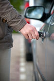 Woman unlocking her car Stock Photos