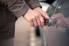 Woman unlocking her car with a key Royalty Free Stock Photography