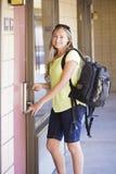 Woman unlocking her Hotel Room Door Stock Photos
