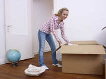Woman unpacking Royalty Free Stock Image