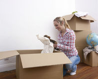 Woman unpacking Stock Photo