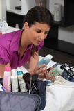 Woman unpacking beautycase Royalty Free Stock Photo