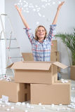 Woman  unpacking boxes. Woman joyously unpacking cardboard boxes Stock Images