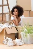 Woman unpacking boxes in her new home Stock Photos