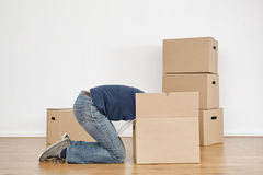 Woman Unpacking Boxes in New Home Stock Image