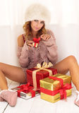 Woman unpacking gifts Royalty Free Stock Photos