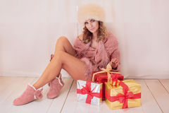 Woman unpacking gifts Royalty Free Stock Photo