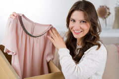 Woman unpacking her online order in the living room Stock Photography