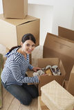 Woman Unpacking Moving Box royalty free stock images