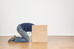 Woman Unpacking a Moving Box Stock Image