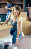 Woman unpacking moving boxes royalty free stock photos