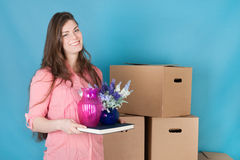 Woman unpacking while moving house Stock Images