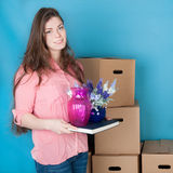 Woman unpacking while moving house Stock Photo