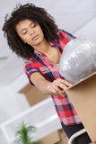 Woman unpacking online order in living room. Woman unpacking her online order in the living room Stock Photography