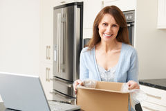 Woman Unpacking Online Purchase At Home Royalty Free Stock Photo