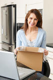 Woman Unpacking Online Purchase At Home Royalty Free Stock Image