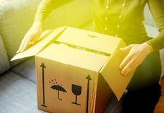 Woman unpacking unboxing cardboard box surprise Stock Photography