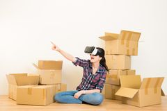 Woman unpacking with VR headset Royalty Free Stock Photography