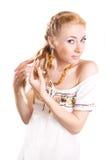 Woman unplaiting her hair Stock Photos