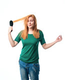 Woman unsuccessfully combed hair Royalty Free Stock Images
