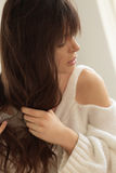 Woman untangles hair. Stock Images