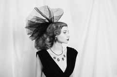 Art black and white photography. Unusual appearance. Woman with unusual appearance in black dress and veil on the head. Black and white art monochrome Stock Photo