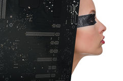Woman with unusual visage and motherboard Stock Photos