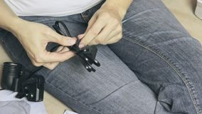 Woman unwinds the wire fastening, fixing cable - electrical equipment preparing for usage.  stock video