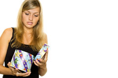 Woman Unwrapping Xmas Gift Royalty Free Stock Image