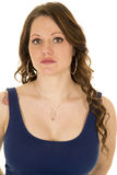 Woman up close in blue tank top looking with rose tattoo. A woman with her blue dress on with her tattoo showing royalty free stock photography