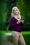 Woman Updating Status on Cell Phone Royalty Free Stock Images