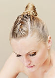 Woman with updo hairstyle. Woman with a braid and bun hairstyle stock photos