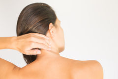 Woman with upper back and neck pain Royalty Free Stock Photography