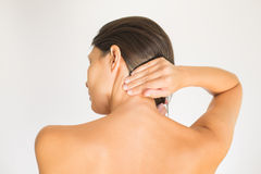 Woman with upper back and neck pain Stock Image
