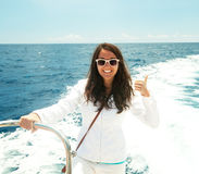 Woman on the upper deck of a cruise ship Stock Photography