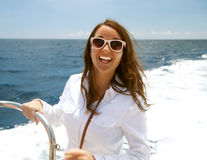 Woman on the upper deck of a cruise ship Royalty Free Stock Photography