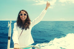 Woman on the upper deck of a cruise ship Stock Image